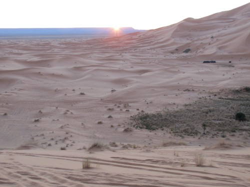 Sun rise over the Sahara Desert, with Algeria in the distance