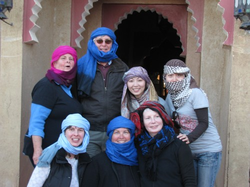 Some of our tour group get into the spirit of riding camels