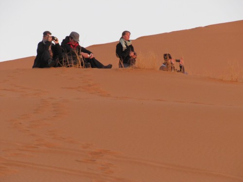 Some of our touring group watching the dawn over the Sahara